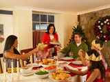 Hispanic family having Christmas dinner