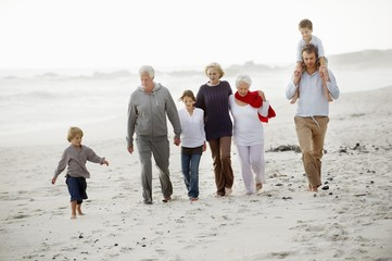 Multi-generation family walking on the beach