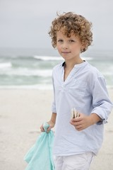 Portrait of a cute boy standing on beach
