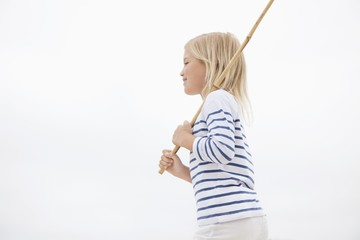 Side profile of a girl holding stick