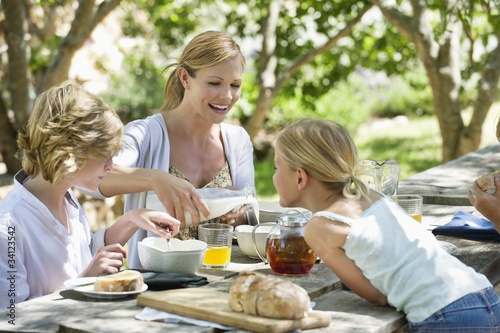 Family having food at front or back yard