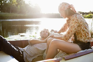 Young couple romancing in the boat