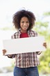 Portrait of a woman holding a blank placard
