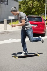 Man skateboarding on the road