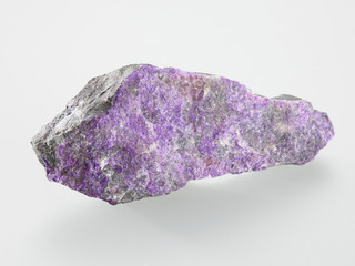 Mineral Sugilit on grey background