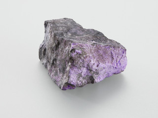 Sugilit mineral on grey background