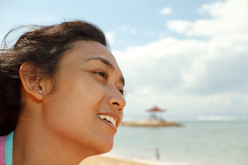 happy ethnic young woman on the beach