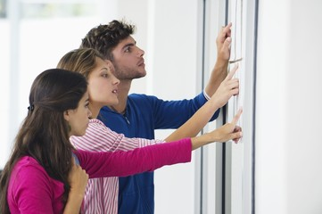 University students checking bulletin board for test result