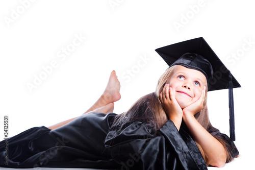 Leinwanddruck Bild Dreaming girl in graduation dress on isolated white