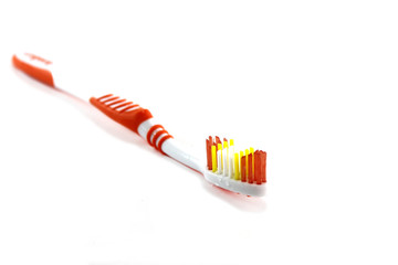 Close up of a orange toothbrush