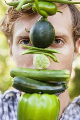 Portrait of a man holding vegetables