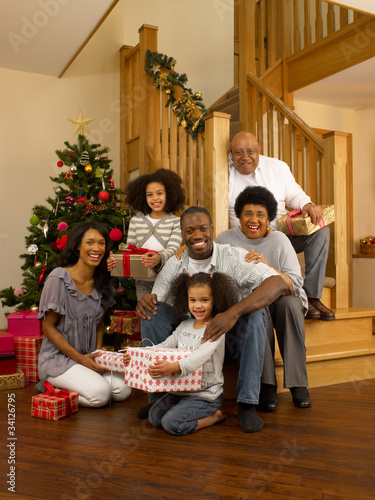 African American family with Christmas tree and gifts