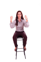Young woman sitting on the stool with compressed fists