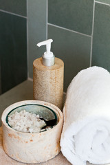 dispenser, bath salt and towel