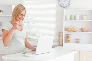 Woman with a cup of coffee and a laptop