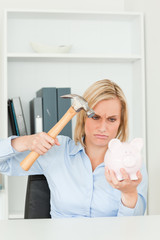 Angry woman wanting to destroy her piggy bank