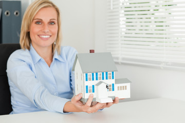 Woman showing model house