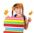 Girl holding pile of books.