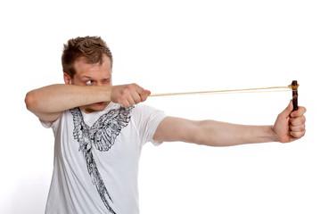 A man aims a slingshot