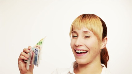Happy woman with money fan