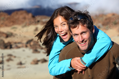 Happy young couple smiling outdoors