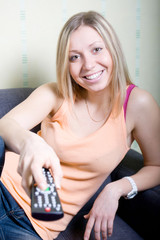 Girl holding a remote