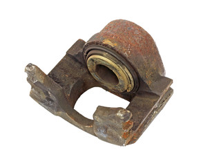 An old brake caliper that is broken on a white background.