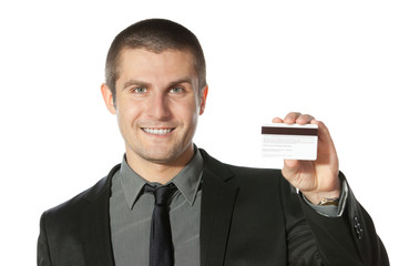 Young smiling businessman holding credit card
