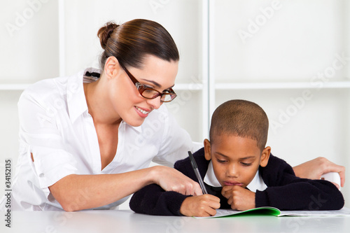 teacher helping primary student