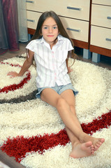 girl sitting on a carpet