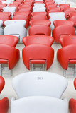 Empty stadion red and white chairs