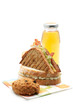 Two sandwiches, apple juice, cookie