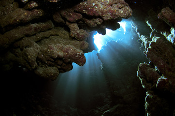 underwater caves with light beams