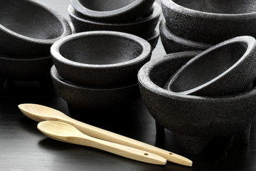 plastic molcajetes and wood spoons