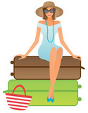 Holiday girl sitting on suitcases