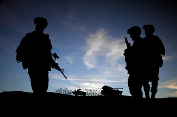 Silhouette of modern soldiers with military vehicles