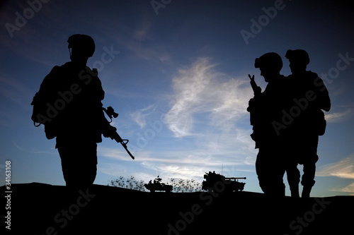 Silhouette of modern soldiers with military vehicles - 34163108