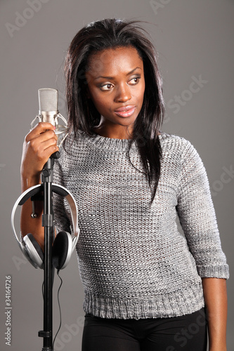 Beautiful black girl singer in studio relaxing