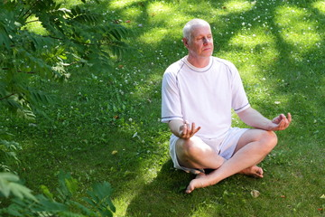 Mature man in yoga meditation pose