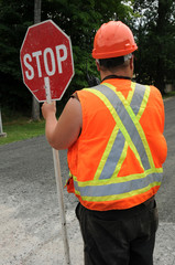 Construction worker holding traffic sign