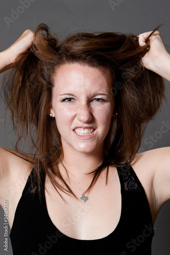 Frustrated Caucasian Girl Pulling Her Hair