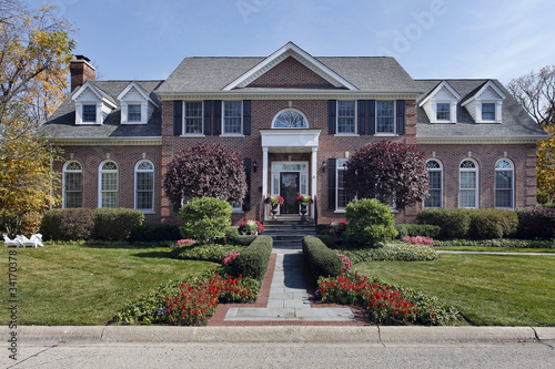 Luxury brick home with columns