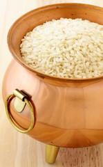 fresh raw risotto on copper pot