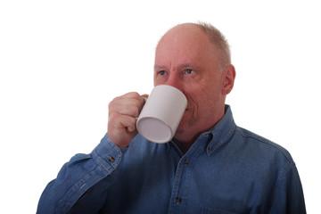 Older Balding Man in Blue Denim Shirt Drinking Coffee to Side