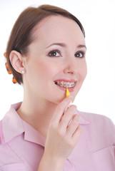 Dental hygenist cleaning teeth