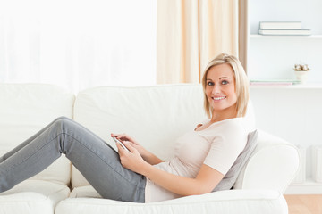 Blonde woman with a tablet computer