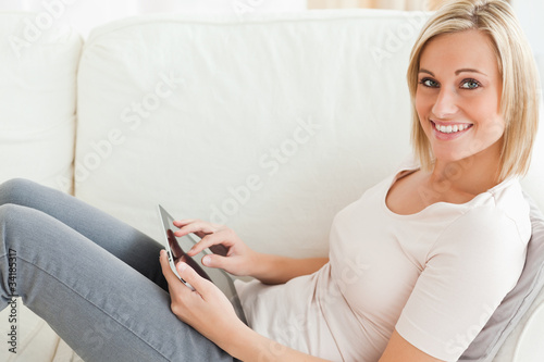 Close up of a woman with a tablet computer