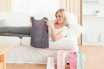 Woman looking at the clothes she bought