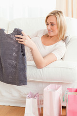Close up of a woman looking at the clothes she bought