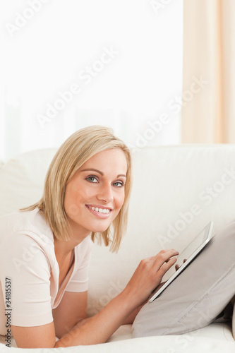 Portrait of a beautiful woman with a tablet computer